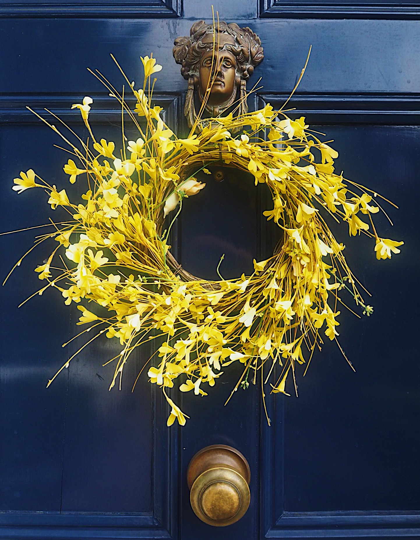 This faux-flower door wreath is from Homesense.
