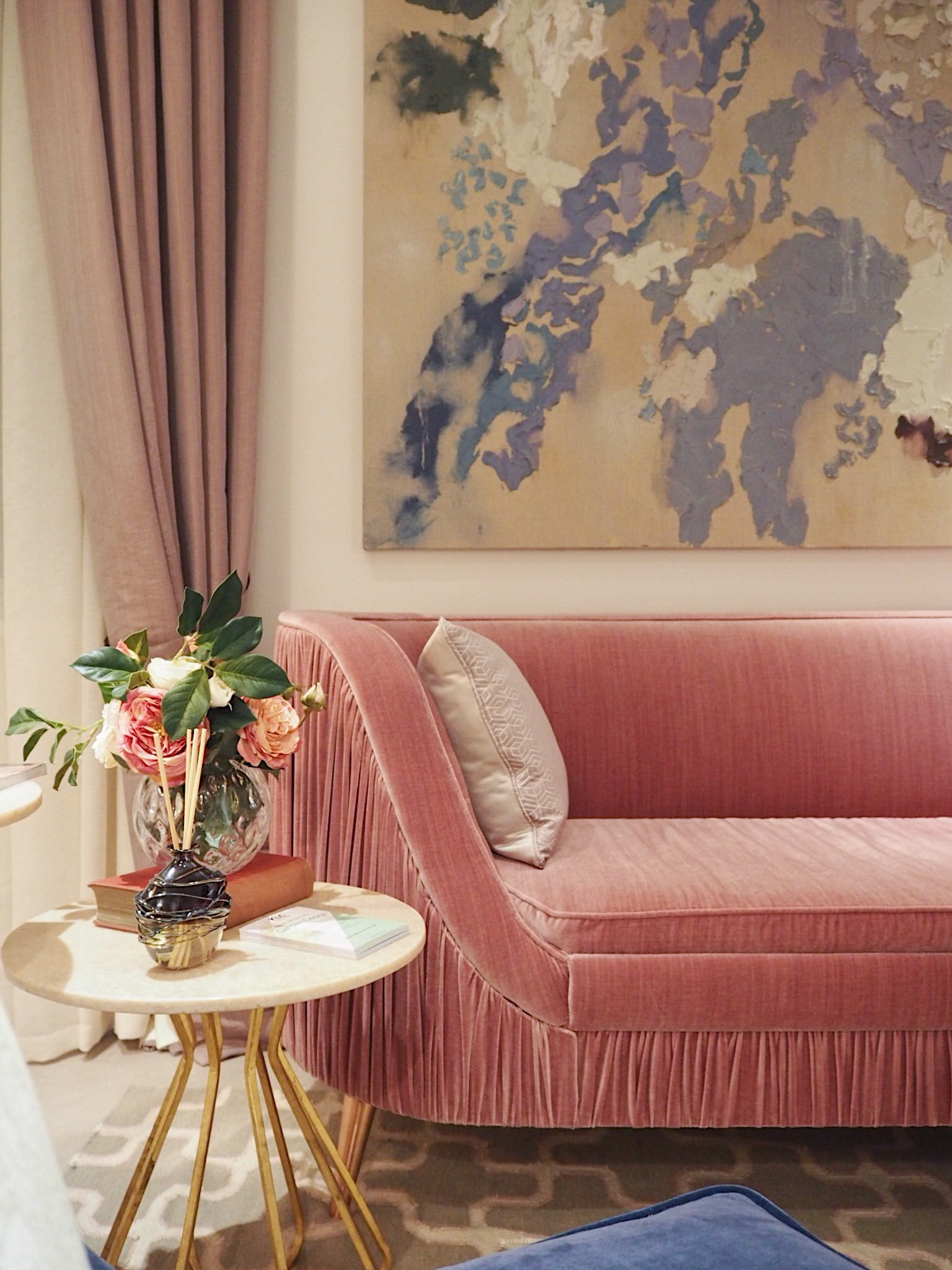 This room was designed by KLC Design School. This amazing sofa is by La Caze and the side table is by Graham & Green.