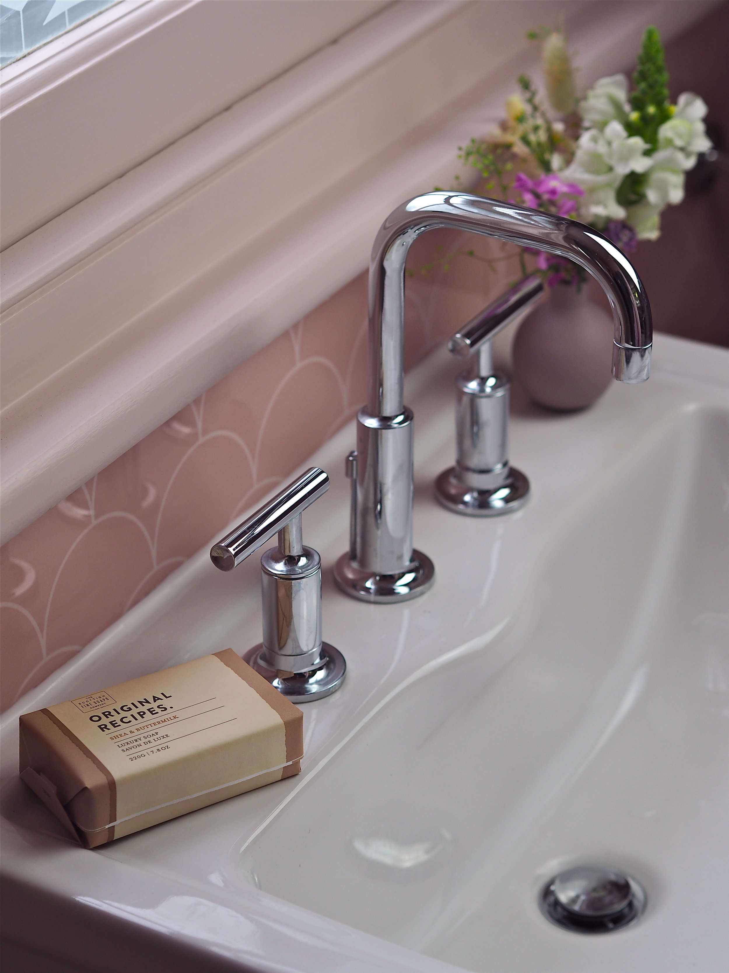 kohler purist taps in bathroom on basin