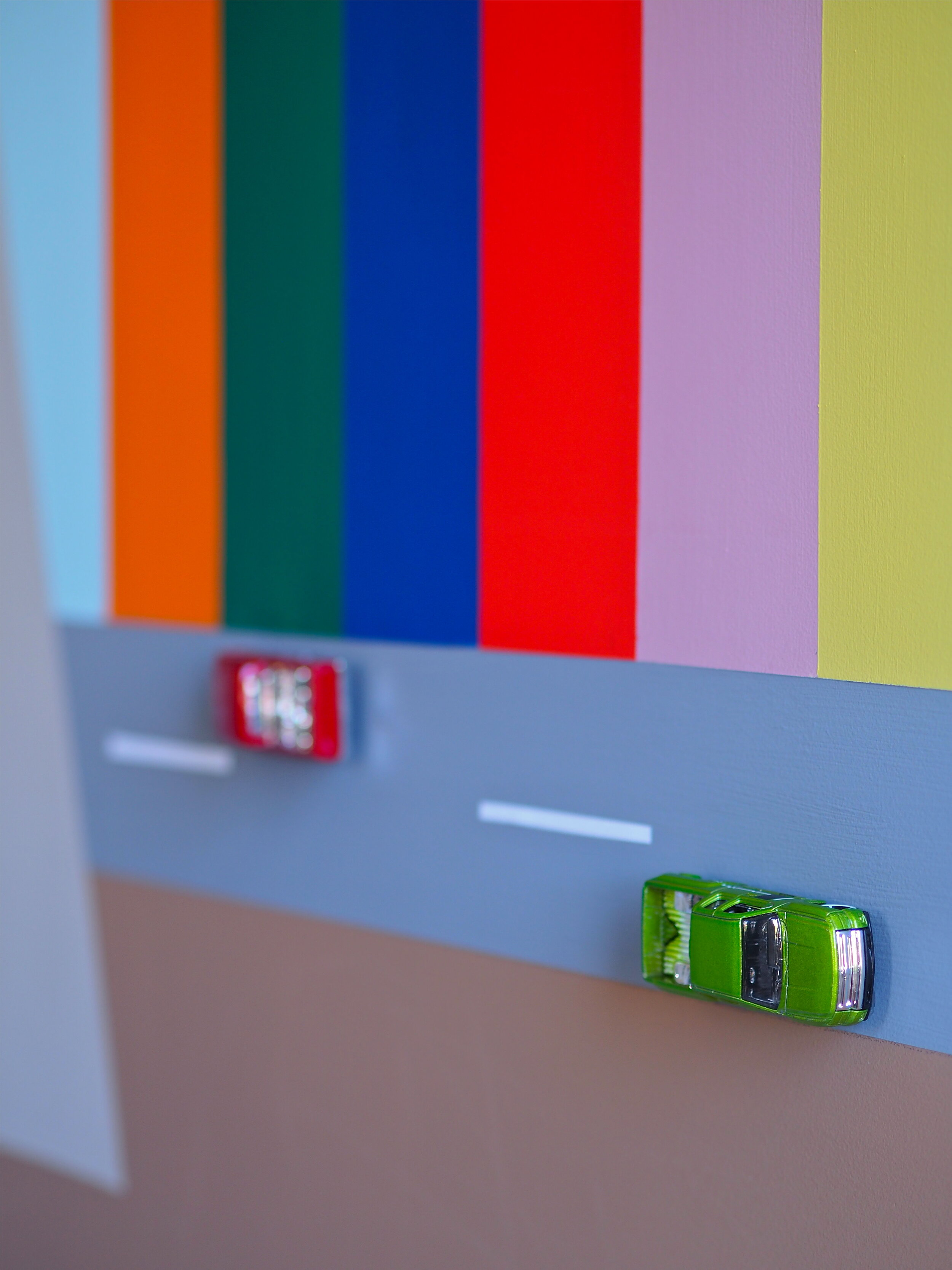 racing cars on wall in childs bedroom