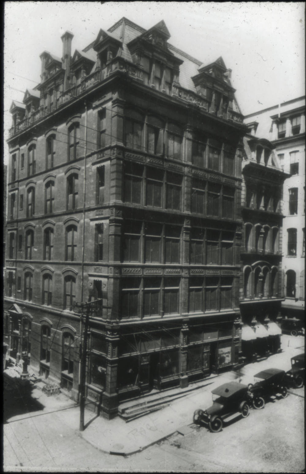 "At the height of his power, George Remus purchased an office complex at 225 Race Street on the southwest corner of Race and Pearl Streets, renaming it the ""Remus Building."" The lobby tile display (allegedly from the famous Rookwood Pottery) spelled out ""Remus,"" which he thought demonstrated his authority. For his second-floor office space, Remus spent $75,000 on lavish furniture, accessories, and equipment, as well as a personal chef.   (Courtesy Public Library of Cincinnati and Hamilton County, Cincinnati History Slide Collection)"