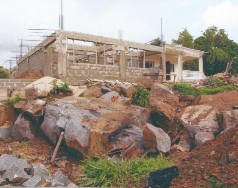 Aug 2014 - Breaking huge boulders to level school site.