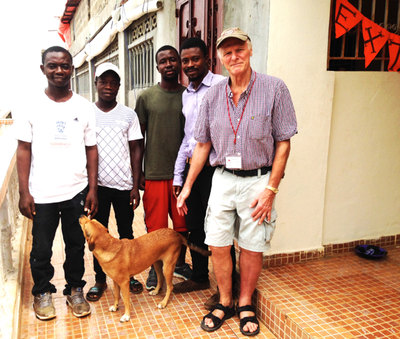 Moses, Mohamed, Ismael, BH, and Mike with our guard dog, 'Rocky'