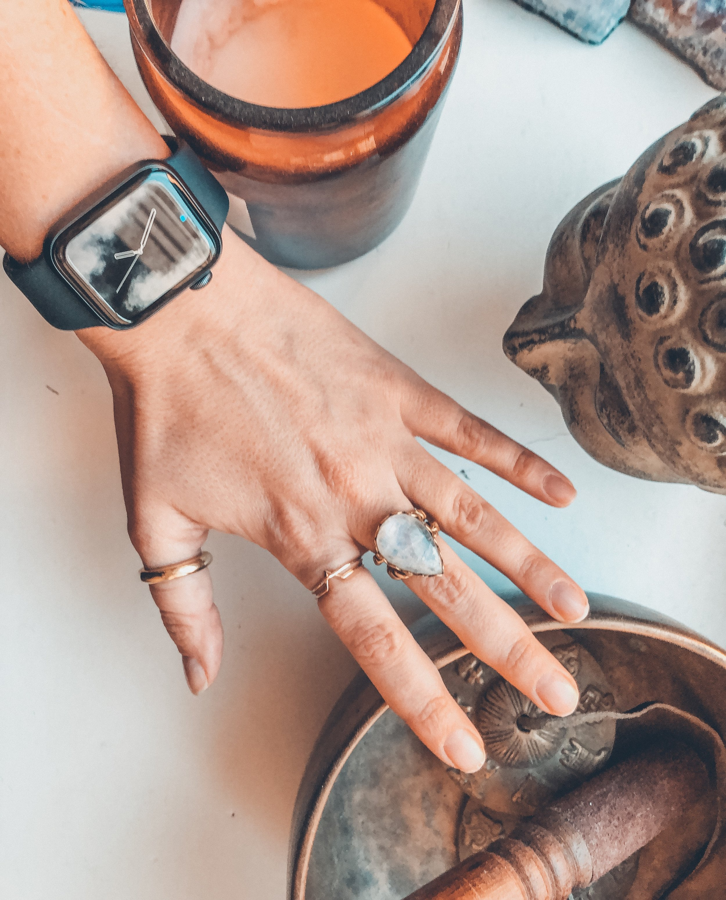An Apple Watch, Buddha, Zafiro jewelry, singing bowls and candles. What else do you need?