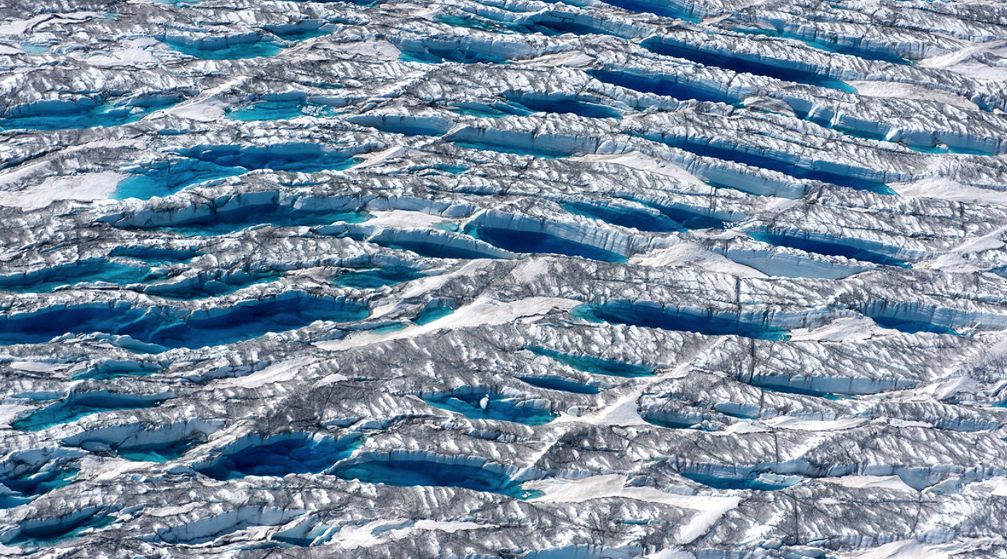 "Ice melting near the edge of the Greenland Ice Sheet, "" while dust and algae darken adjacent ice"".   (Adam Lewinter, Extreme Ice Survey)"