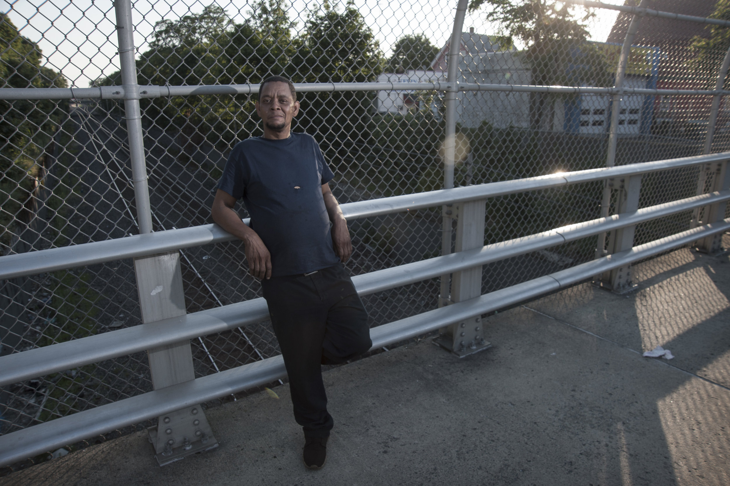 12 Lynn man on Bridge at sunset.jpg