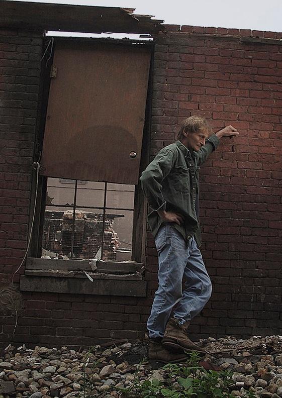 Man against wall in Amesbury.jpg
