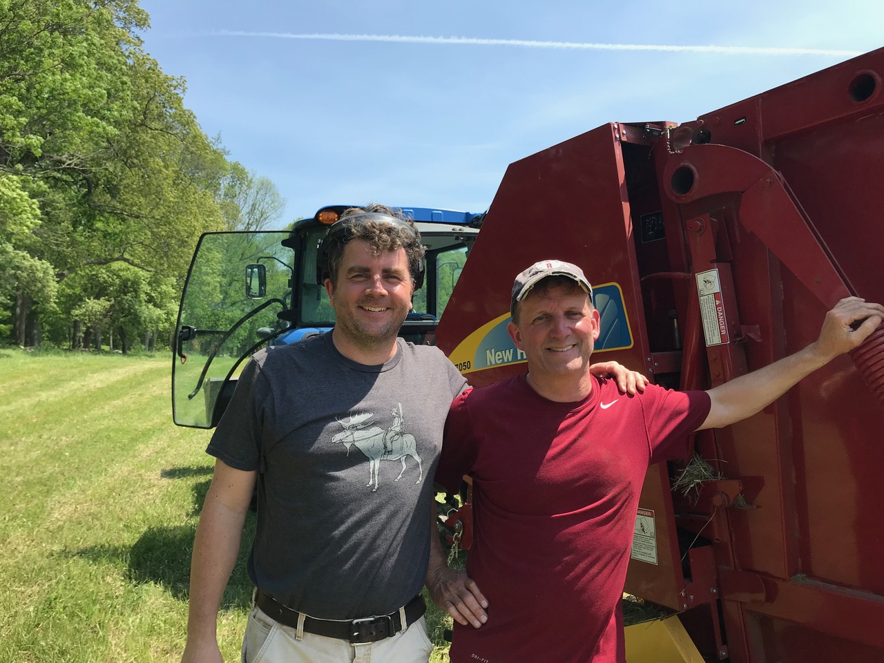 Andy Stevenson and Bob Robichaud tag teamed to get the hay cut and baled on a hot summer day.