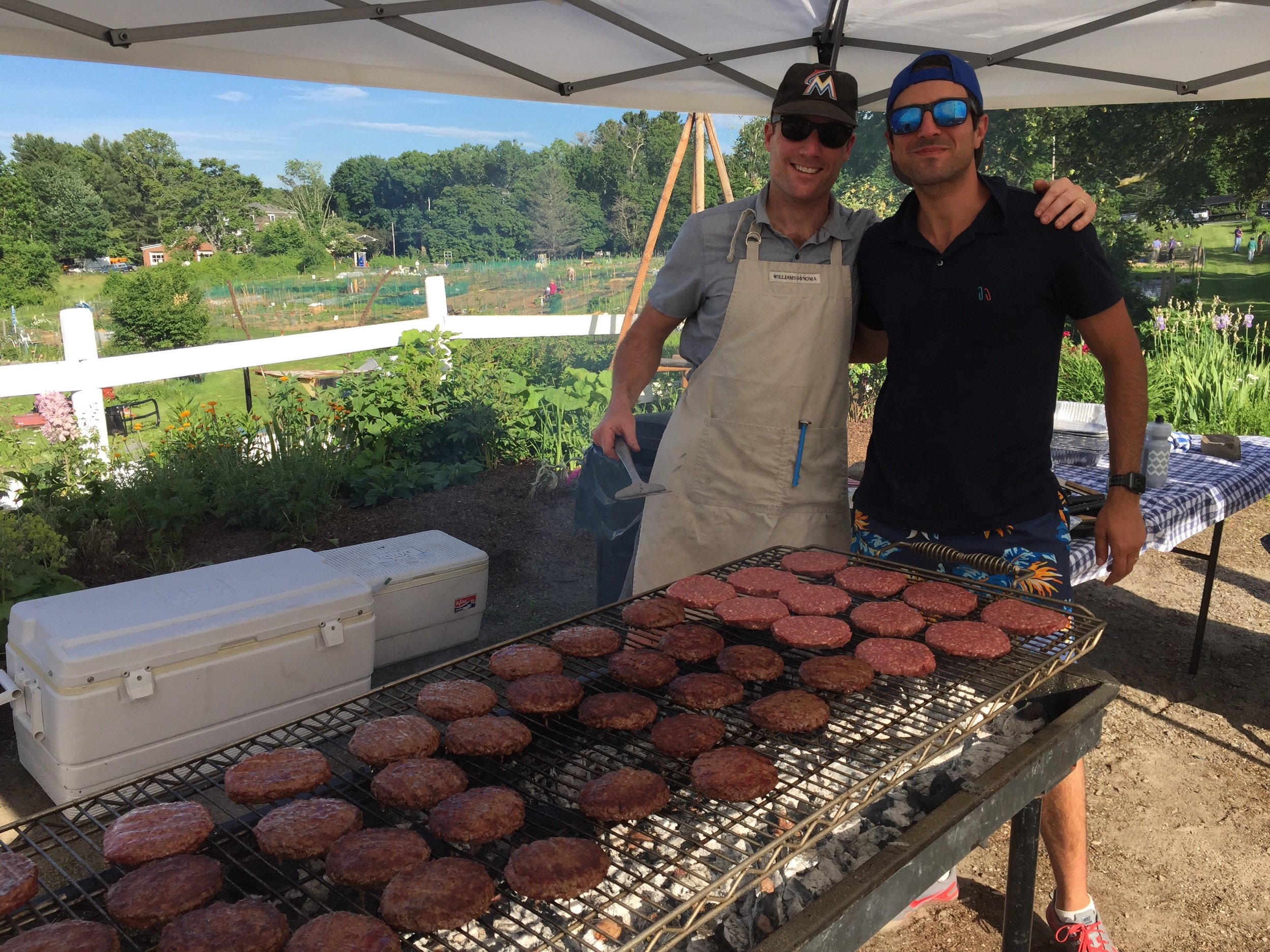 John and Jon, board members during the week, grill masters on the weekend!