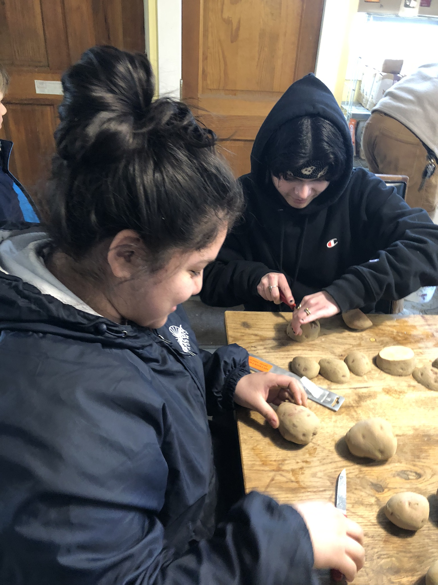 Waldorf High School students cutting up seed potatoes