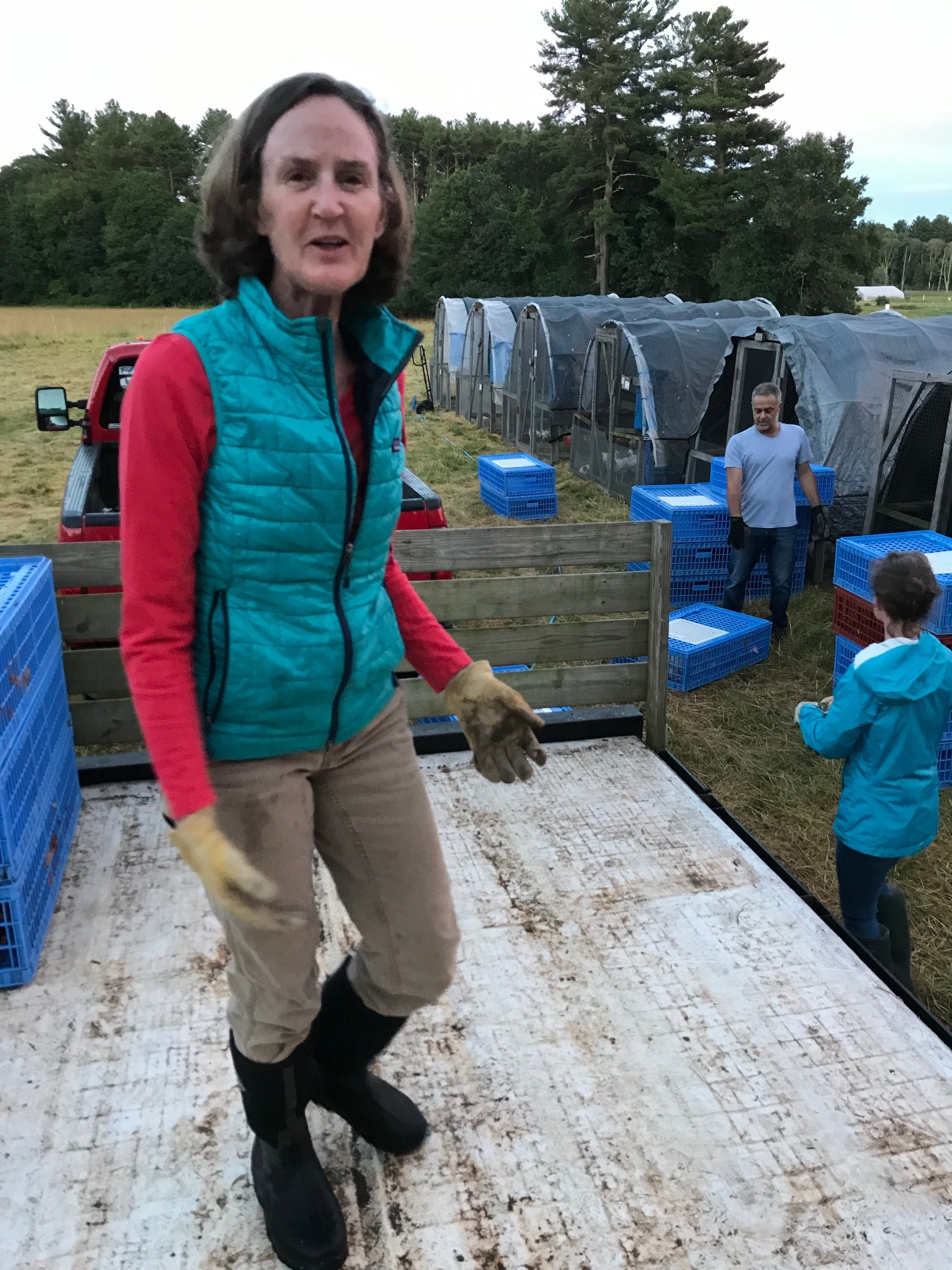 Board President Nancy Fleming in the field directing chickens.