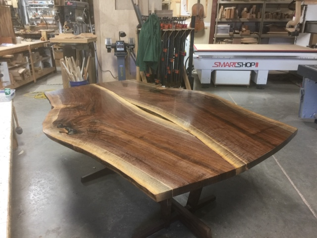 "This has been one of my favorite projects this year.   The Oregon Walnut was harvested over 2 years ago from a friend's property in Salem.   I had seen the ""yin-yang"" overlapping of bookmatched slabs, and always wanted to do it.   The planets aligned with a client willing to give me some creative freedom and here is the result.  We filled the void with an arrangement of mussel shell and clear epoxy."