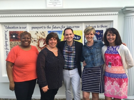 """Michael J. Ferreira and Barnstable Public School employees celebrating the unveiling of """"Pieces of Our Past"""""""