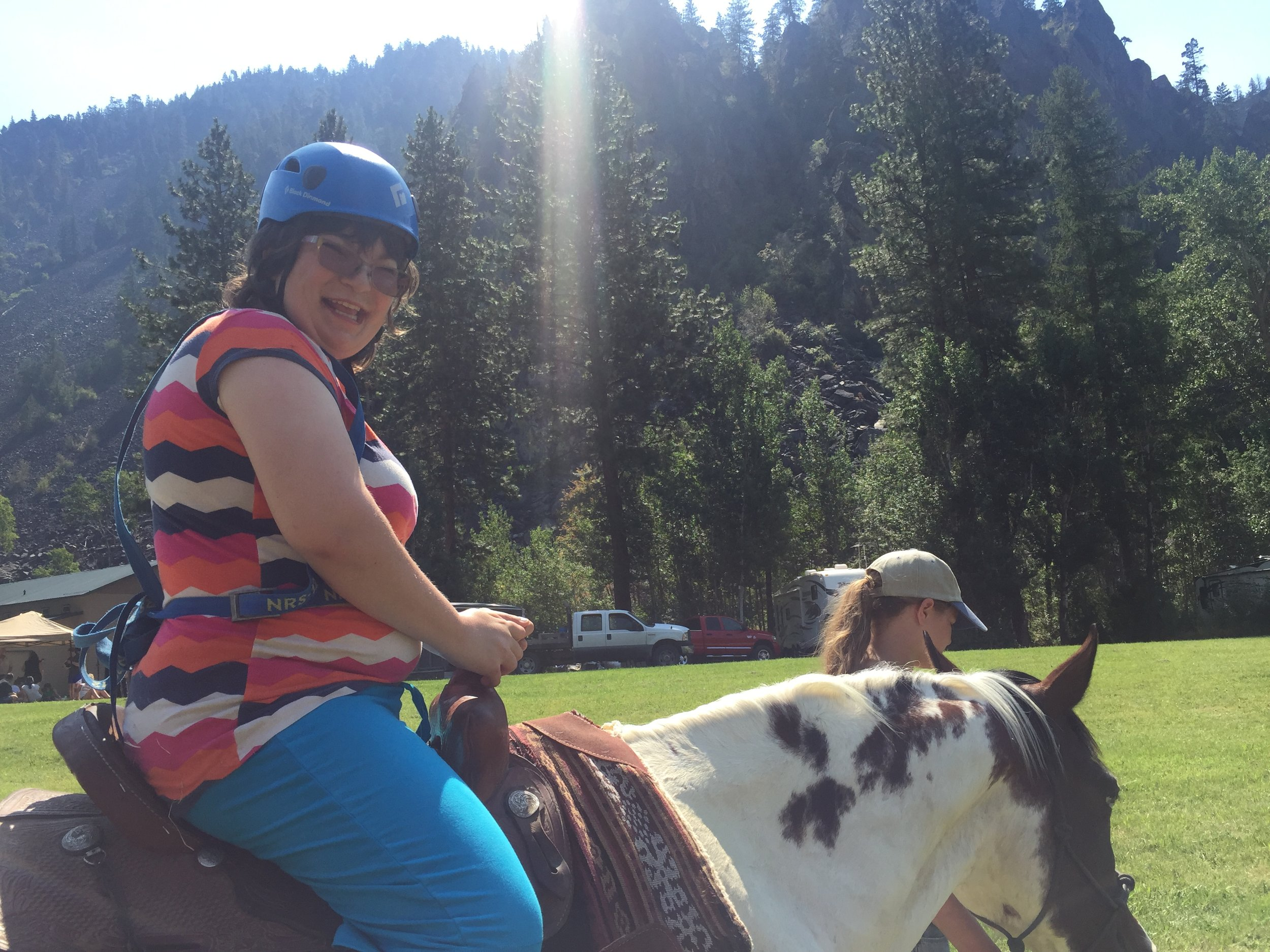 """Our ever-smiling Rachel, diagnosed with mental delays and sensory processing disorder, conquerors her initial fear of the horses and gleefully rides """"Boots."""""""