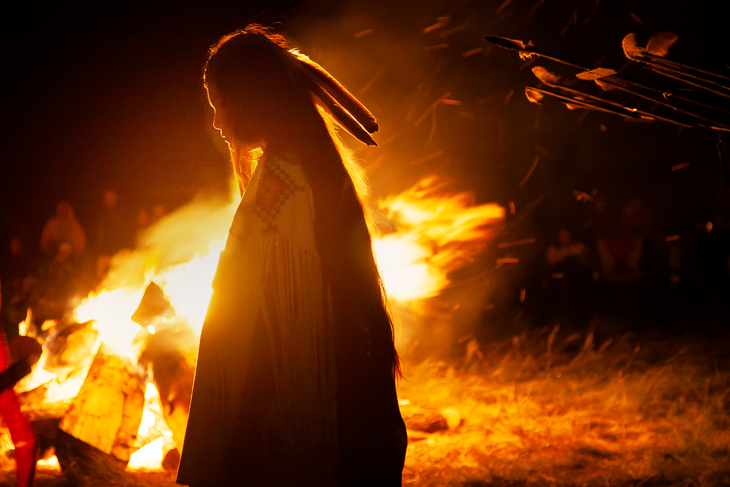 Malia Enjady, silhouetted by the campfire