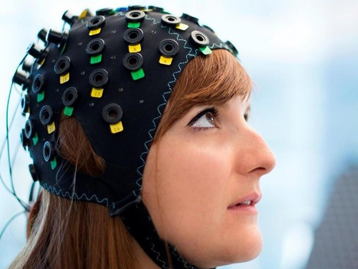 The new device uses infrared light to measure blood flow in the brain. Image credit: Wyss Center