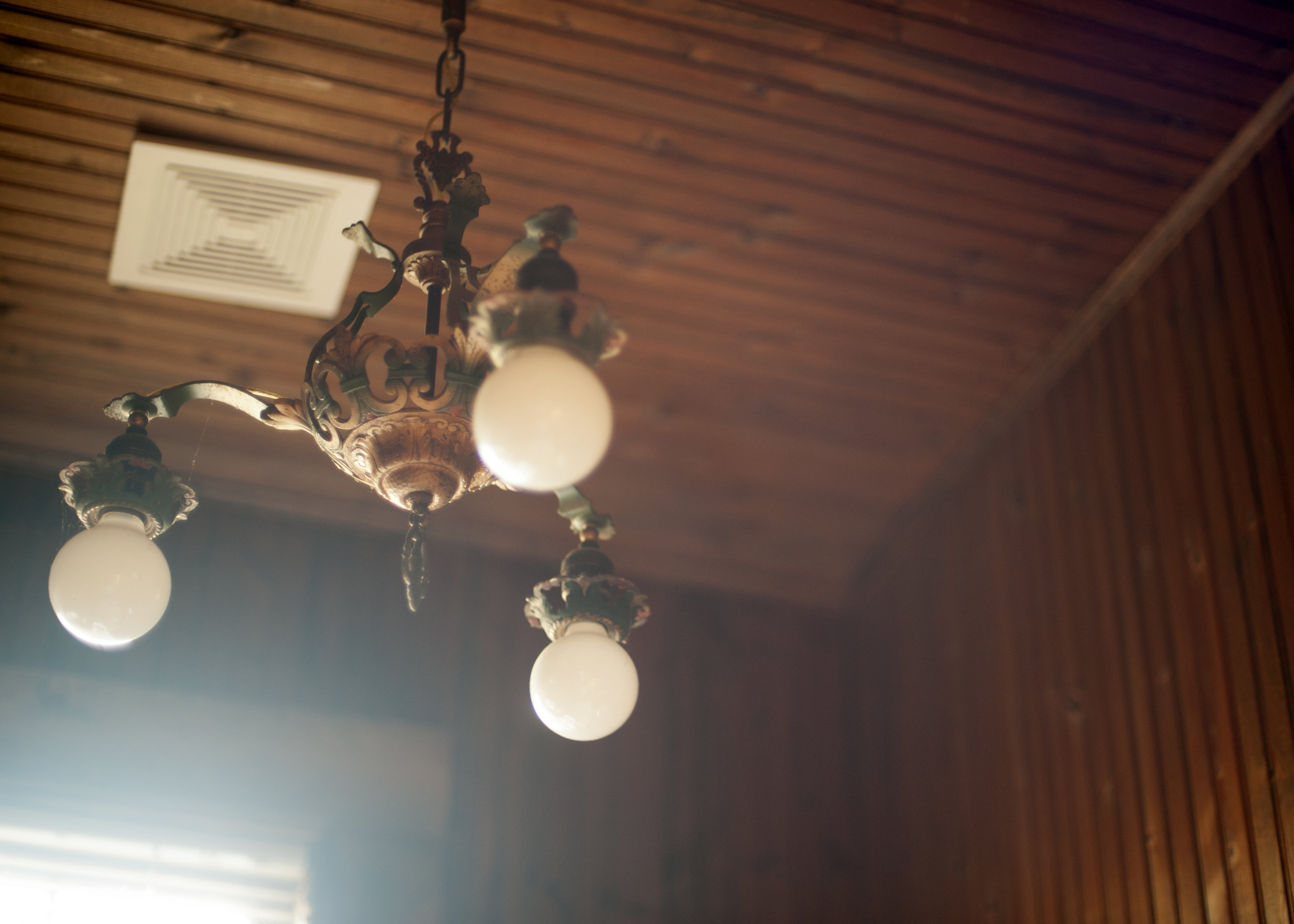 This chandelier is one of the many remnants of the building's heritage. Image credit: Emily Bartos