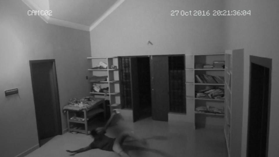 A still from the video that shows the teen flailing around after the attack.