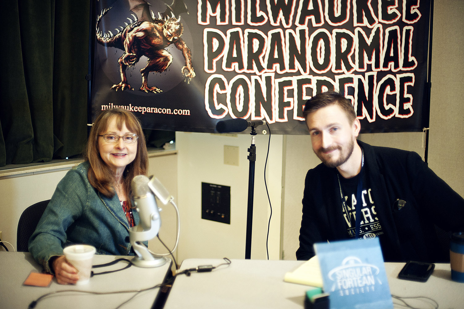 Linda Godfrey (left) with The Singular Fortean Society's Tobias Wayland at last year's Milwaukee Paranormal Conference.