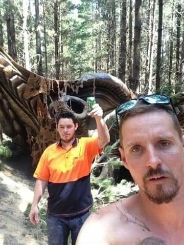 This image attached to case #99500 shows two men taking a selfie in front of the 'UFO.'  (MUFON)