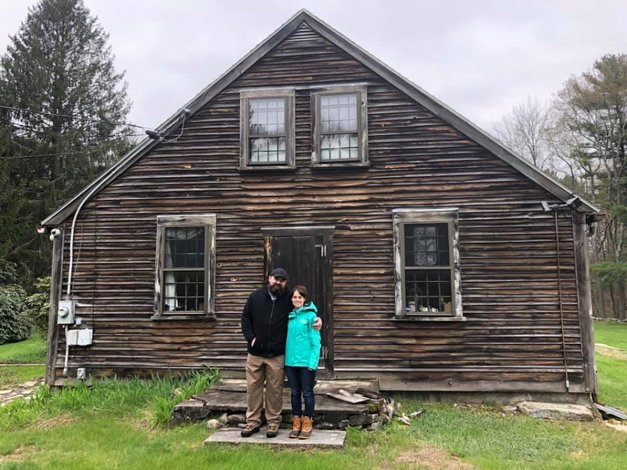 Cory and Jennifer Heinzen in front of their newly purchased property.  (Cory Heinzen / Facebook)