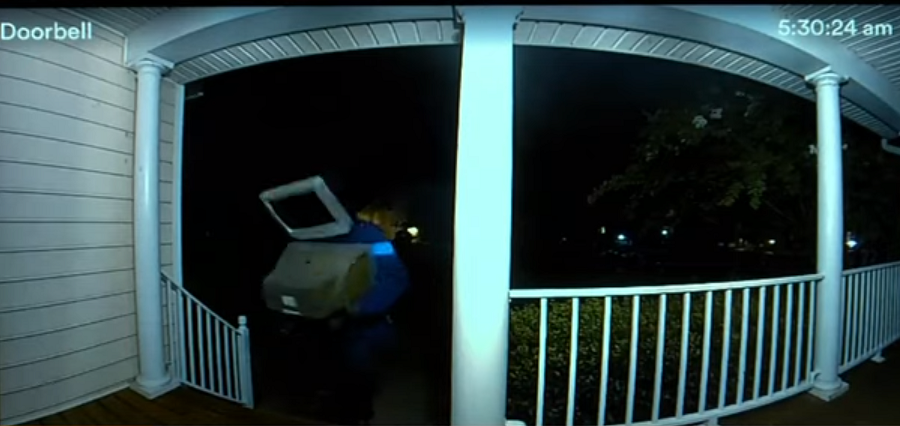 Security camera footage of the mysterious delivery person.  (WSLS 10)