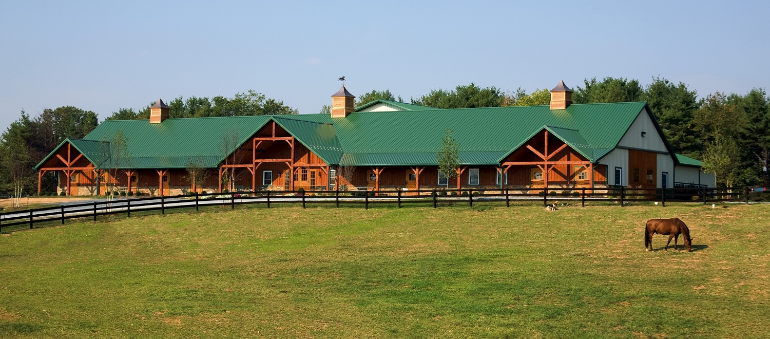 "Our spacious 18 stall barn was designed for comfort of both horse and owner, and received the Barn Builders' Association ""2007 Horse Barn of the Year"" award"