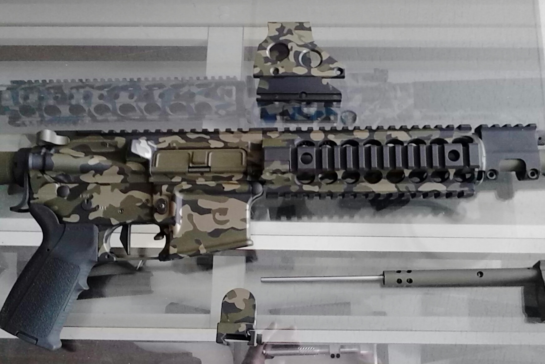 Recent three paint Cerakote camo job on an AR-15