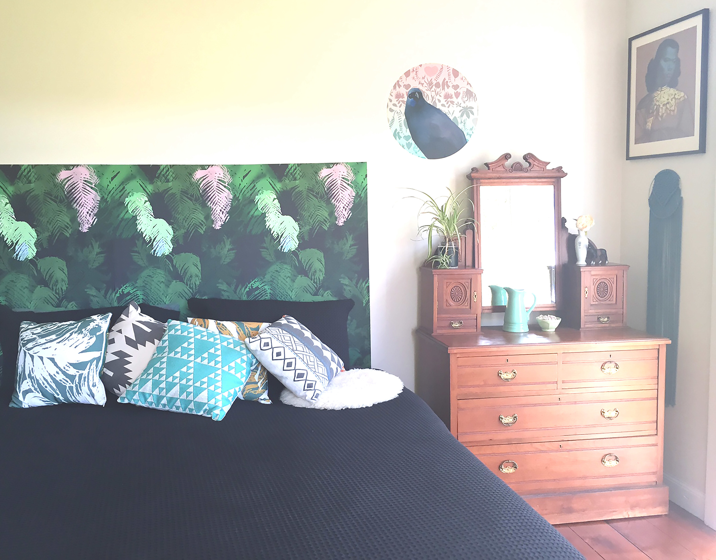 This is my nz ferns wallpaper used as a headboard on a Super King bed.