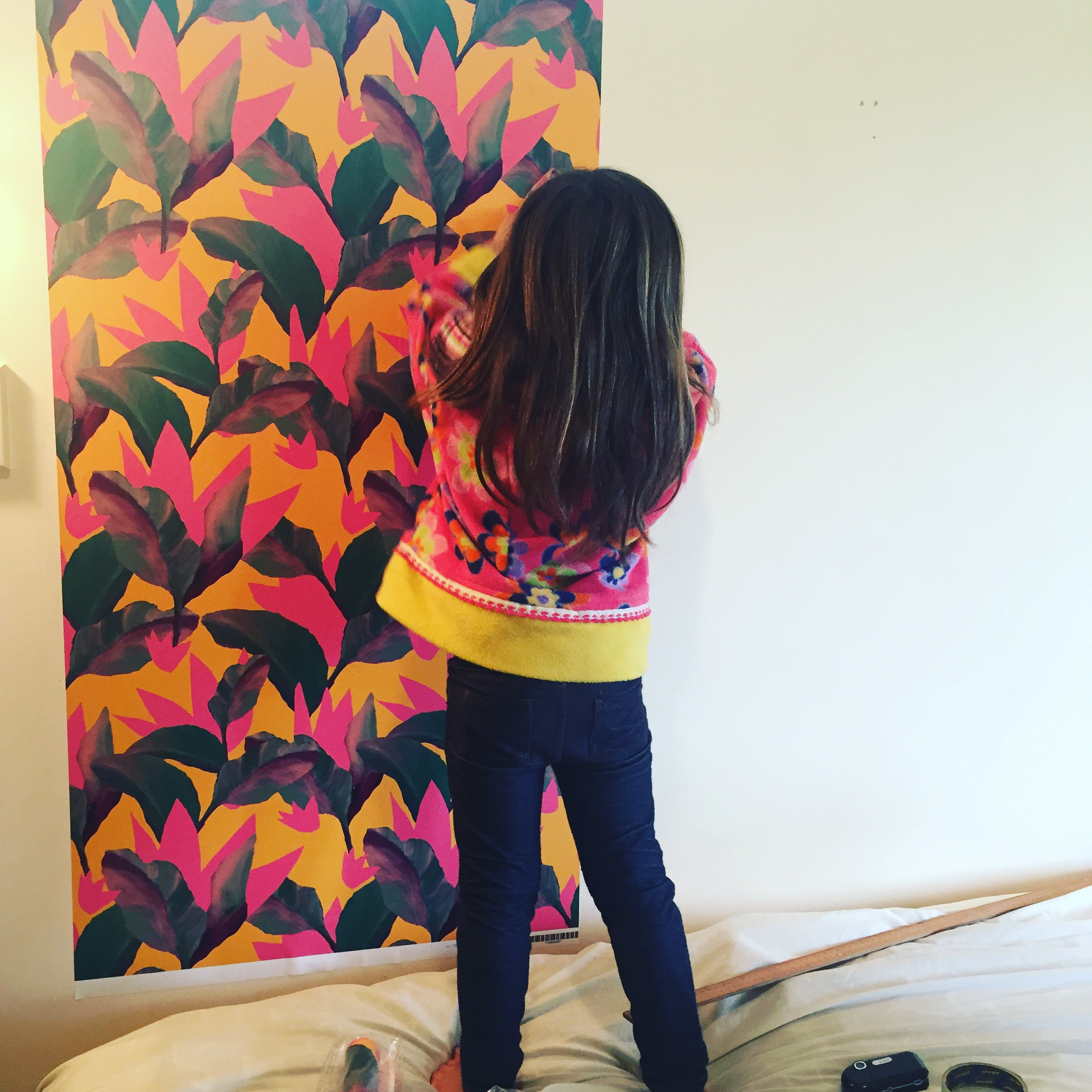 Hanging the wallpaper was so easy - even our four year old was able to help in her conveniently matching top. These custom drops of wallpaper are available via my spoonflower store in lengths by the foot and as fabric by the yard in a range of fabric types.
