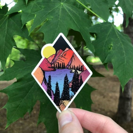 Image Credits:  https://roamwilddesigns.com/products/diamond-pines-in-the-moonlight-mountain-scene-sticker