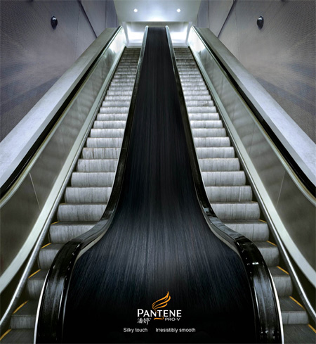 Long Silky Smooth Hair Promise via Pantene's Escalator Sticker Ad  Image Credits:  http://www.toxel.com/inspiration/2009/08/19/clever-and-creative-escalator-advertising/