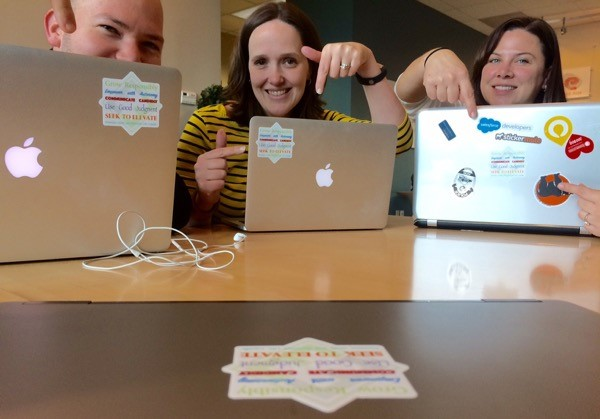 ExactHire's Team with the Die-Cut Stickers of the Organization's Values  Image via  ExactHire Blog