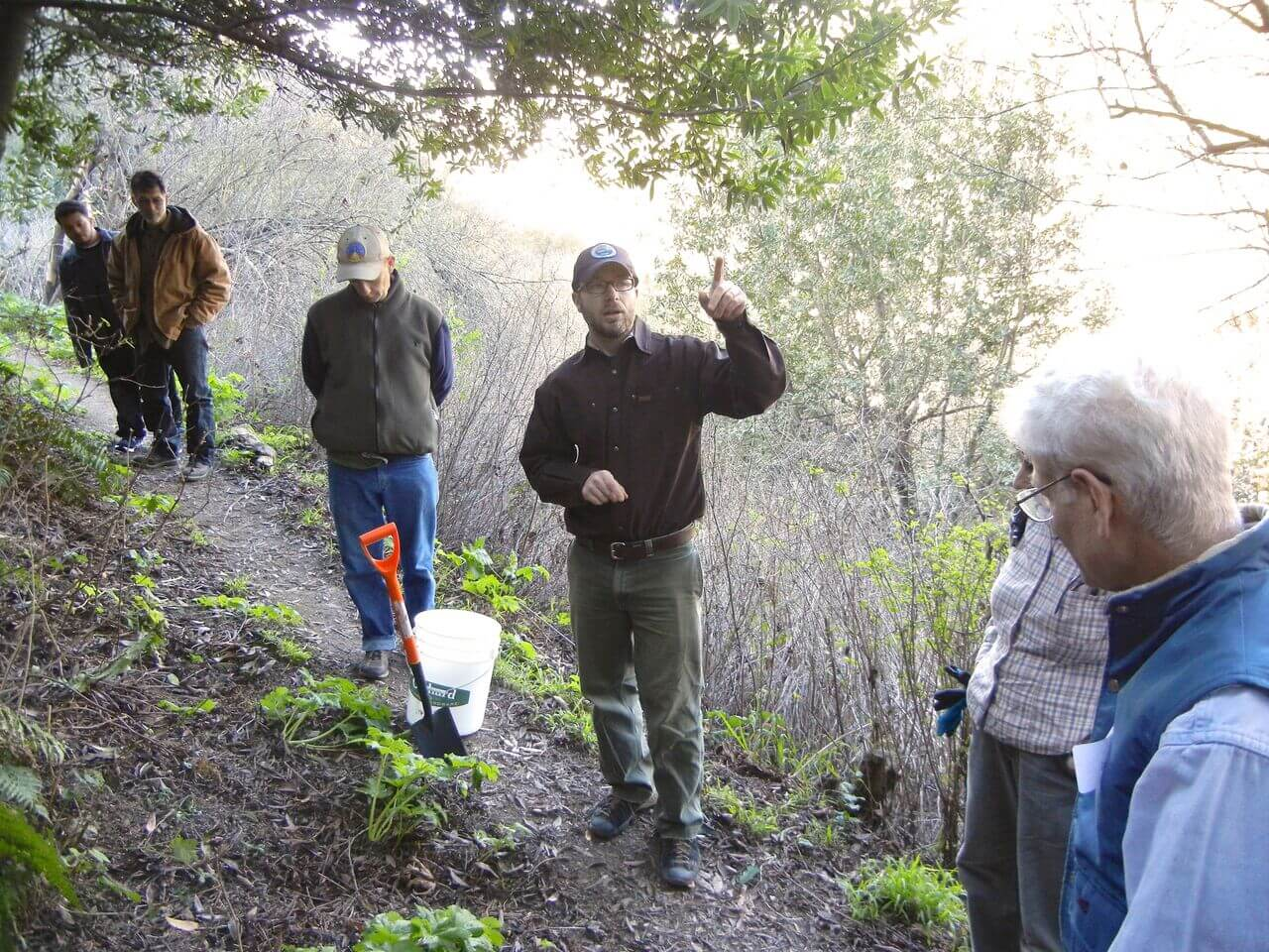 Workshop leader, Lech Naumovich, teaches the group how to transplant native cowparsnips  .