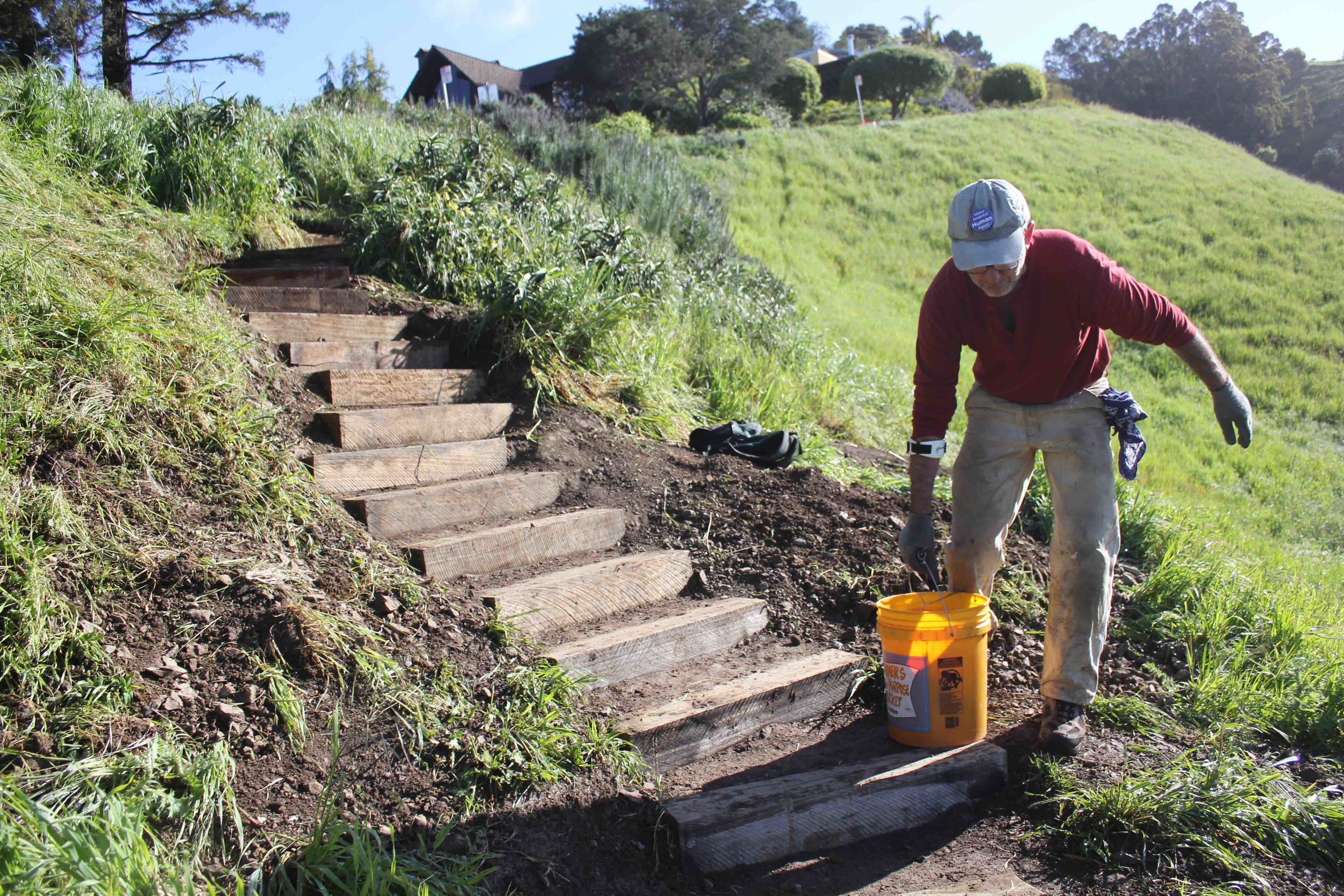 Author, Jim Rosenau works on the stairs leading to upper Dwight Way.