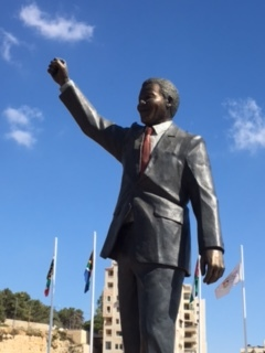 "A 20-foot-tall statue of Nelson Mandela given to the West Bank city of Ramallah by the city of Johannesburg, South Africa. Mandela had stated: ""We know all too well that our freedom is incomplete without the freedom of the Palestinians."""