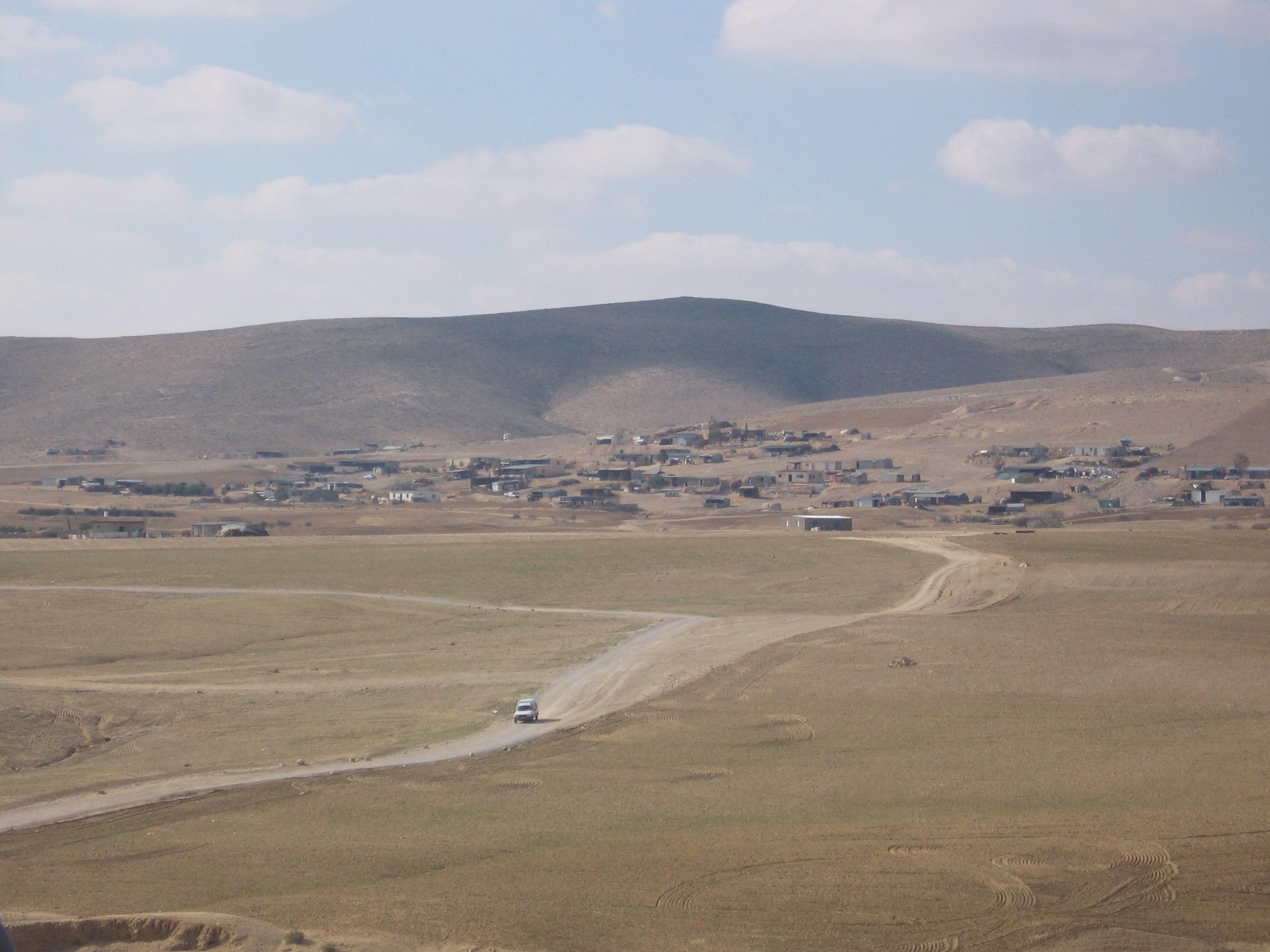 Unrecognized Bedouin Village in the Negev [ Source: Wikimedia ]