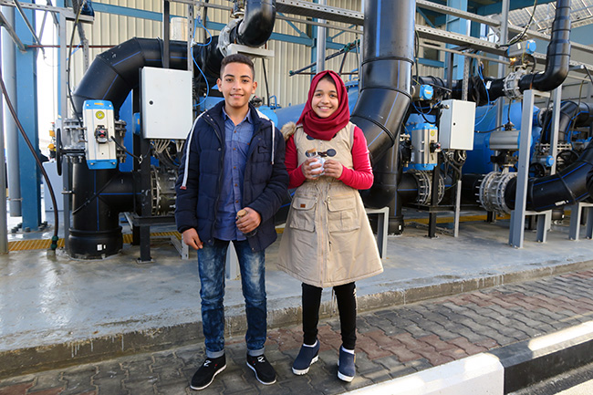 Thirteen-year-old Ahmad and 12-year-old Shahd stand in the new seawater desalination plant. Their class went on a tour of the plant as part of a UNICEF-supported C4D campaign to raise awareness about the safe water. Photo credit: UNICEF State of Palestine/2017/Weibel