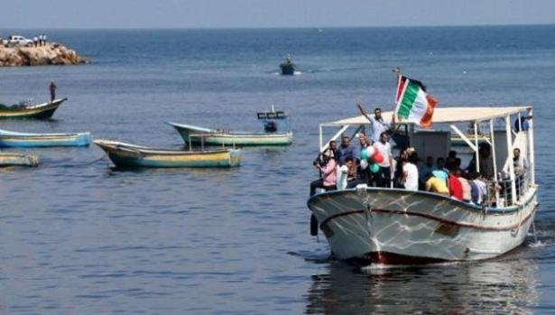Palestinians ride a boat as they take part in a rally to show solidarity with Gaza-bound flotilla Oct. 5, 2016., Reuters