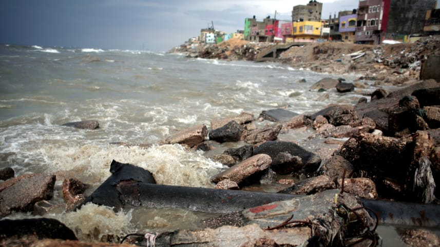 FILE PHOTO: Sewage flows from an outlet into the sea in front of Shati refugee camp in Gaza City, April 12, 2016 Photo credit:  Khalil Hamra / AP