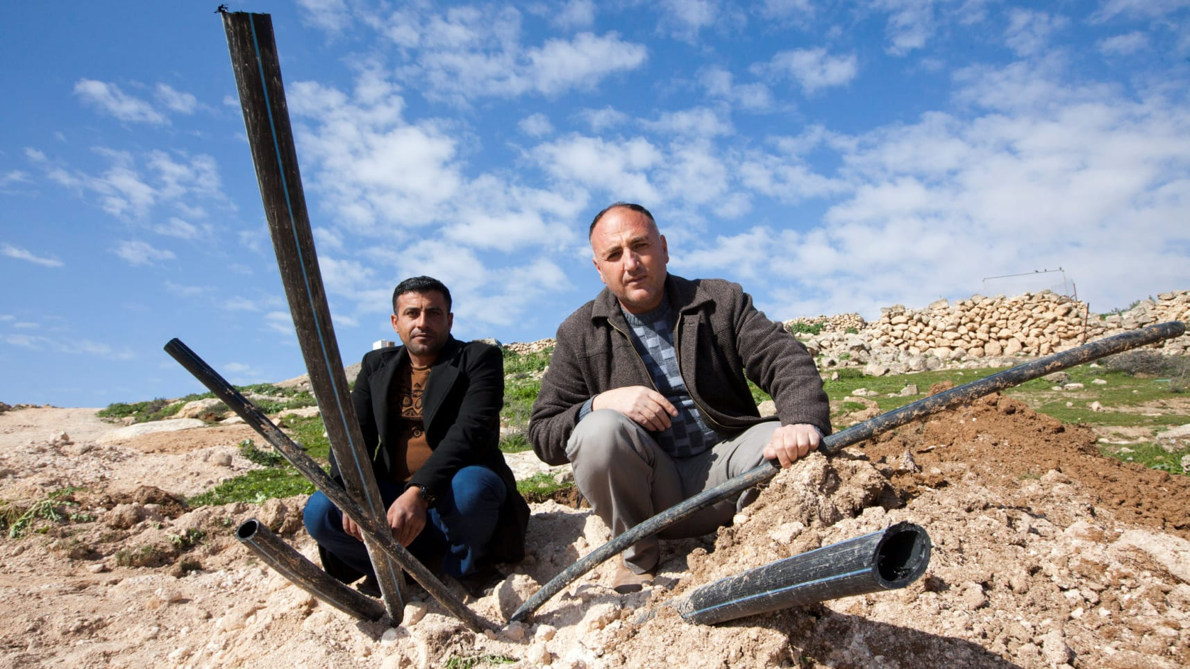 Younes (right) and al-Raba'i with what remains of the water pipes. February 17, 2019. Photo Credit:  Eliyahu Hershkovitz