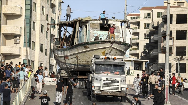 The return of the boat over land left al-Habil with a $3,000 transport bill [Walid Mahmoud/Al Jazeera]