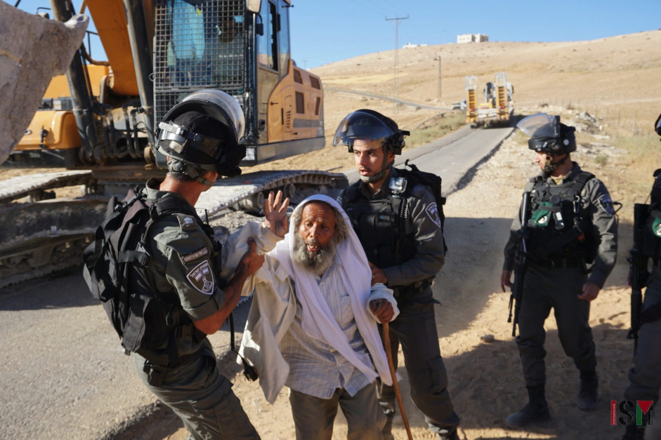 A village elder is detained while trying to protect water sources on July 4.