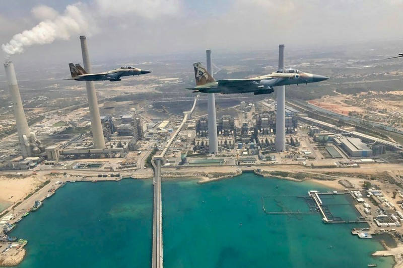 Israeli warplanes make a ceremonial flyby of the Israel Electric Corporation's Orot Rabin coal-fired generating station, to mark what Israel calls its Independence Day, May 2017. The power company is deeply complicit in Israel's violations of Palestinian rights. ( via Facebook )