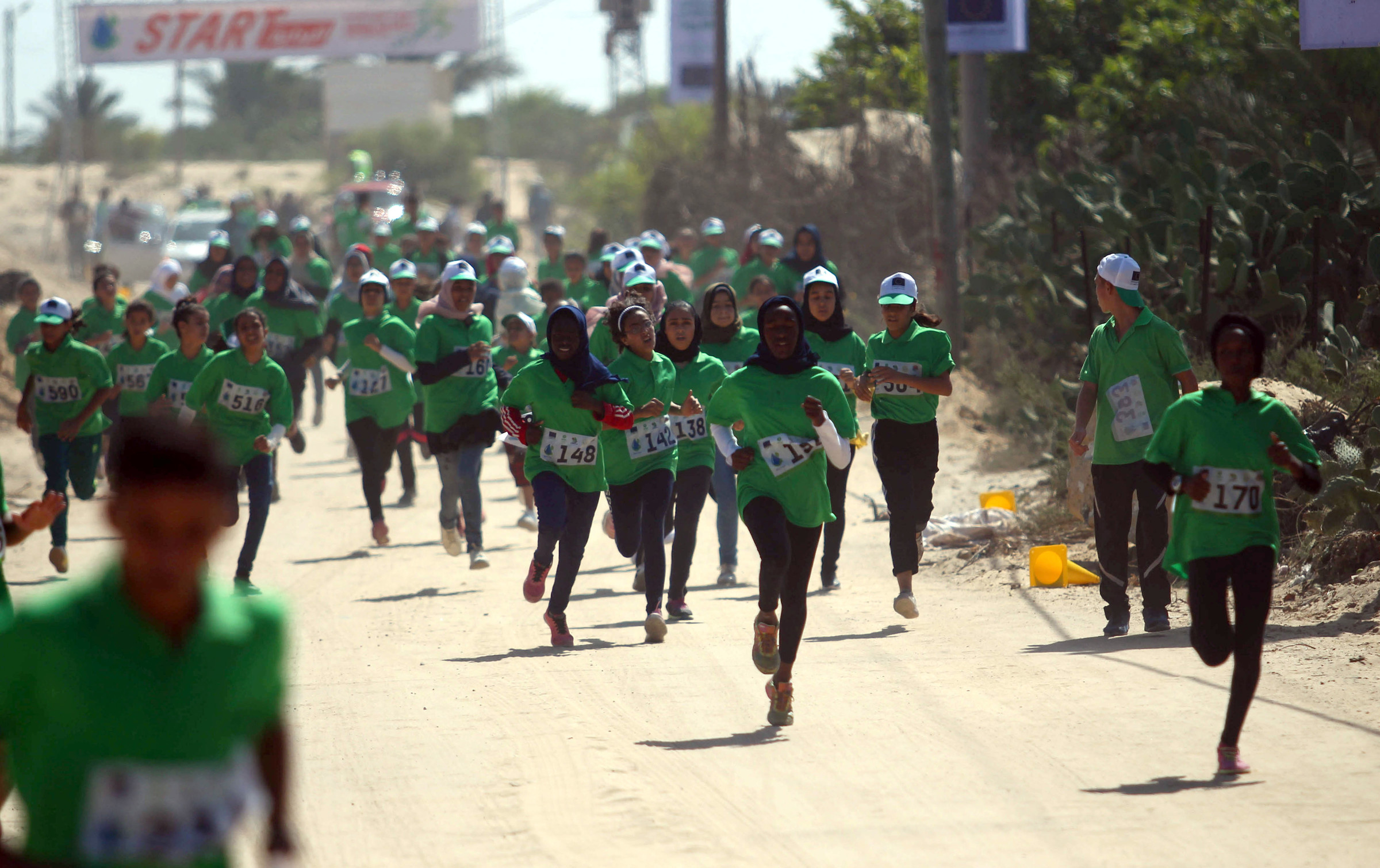 """Palestinians take part in the """"Running for Water Cross-country Run"""" in Rafah, southern Gaza Strip, on 26 September.  Mahmoud AjjourAPA images"""