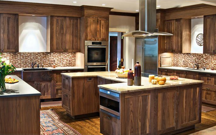 The U-Shaped kitchen island is the chef's dream come true. Out of all the designs, it is by far the largest and most accommodating. This style of kitchen island provides plenty of room for seating and room for appliances. It also includes three walls that can be used for shelves or cabinets. If you are passionate about cooking or baking, the U-Shape would be a good fit in your kitchen.