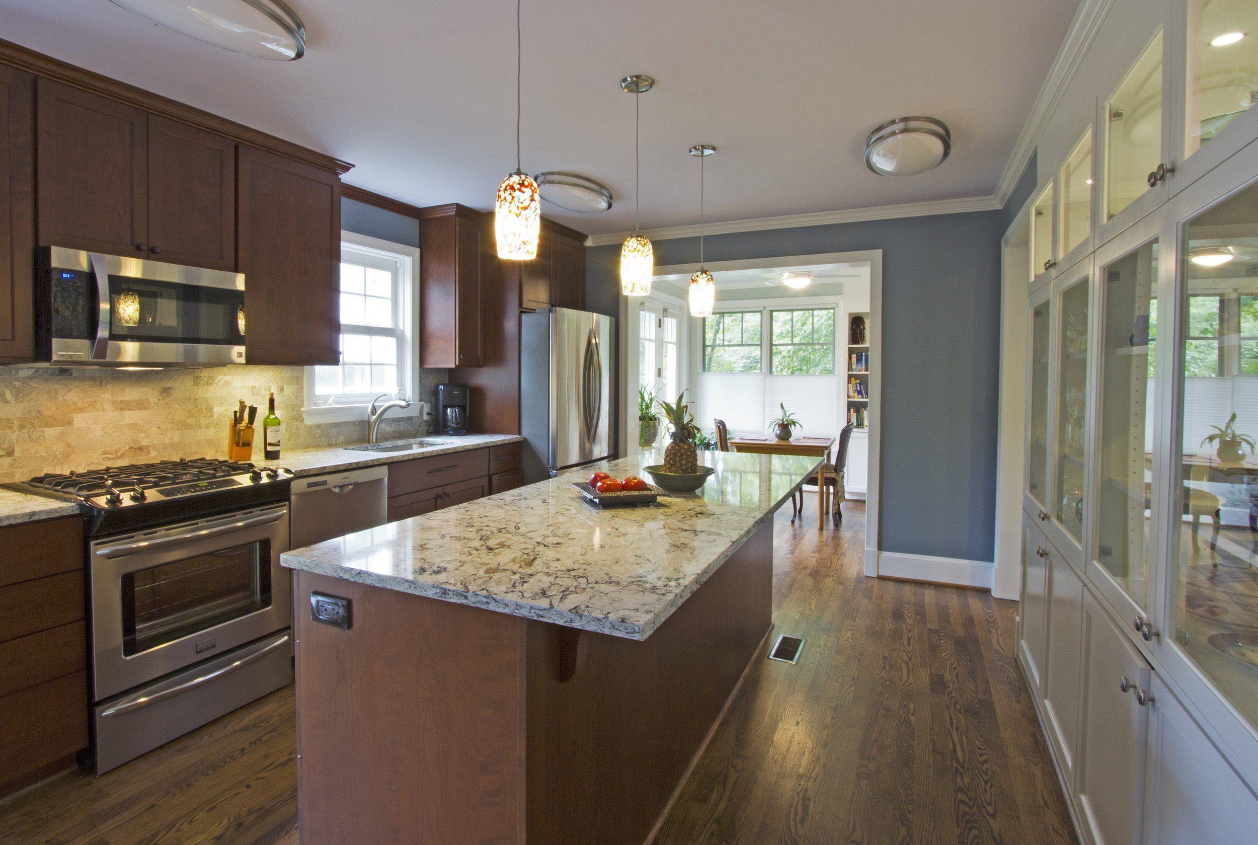 The Galley style of kitchen islands is the most straightforward, and works well for most kitchen layouts. It also provides optimal amounts of storage, and is best paired with bar-style seating. This kitchen island would work well for someone looking to maximize their storage space or have additional seating in their kitchen.