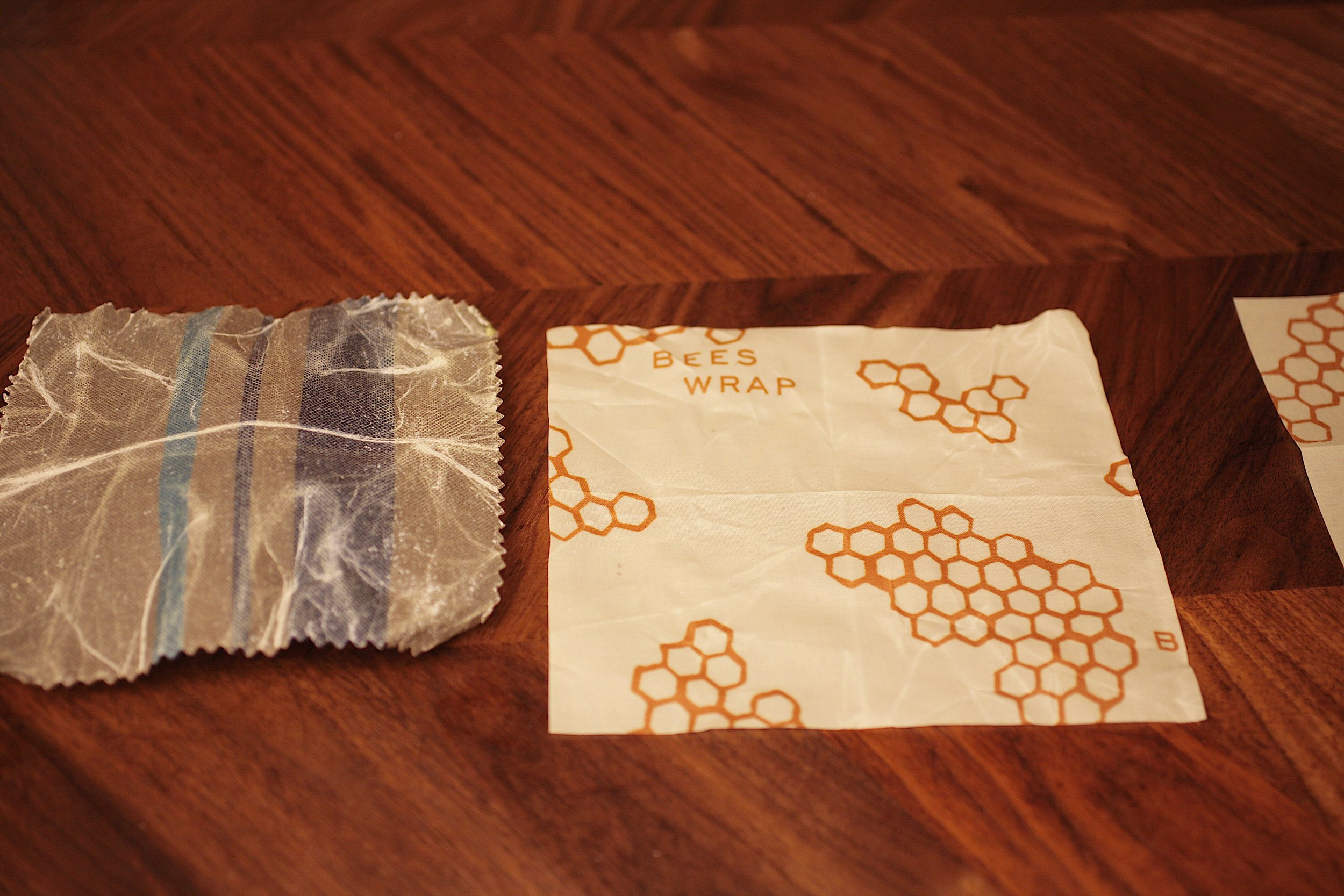 The Trader Joe's Waxed Cotton Food Wraps are stiff and very hard to use. They leave a sticky-waxy substance on your hands. The Bee's Wraps are malleable, thin, and are much more user-friendly.