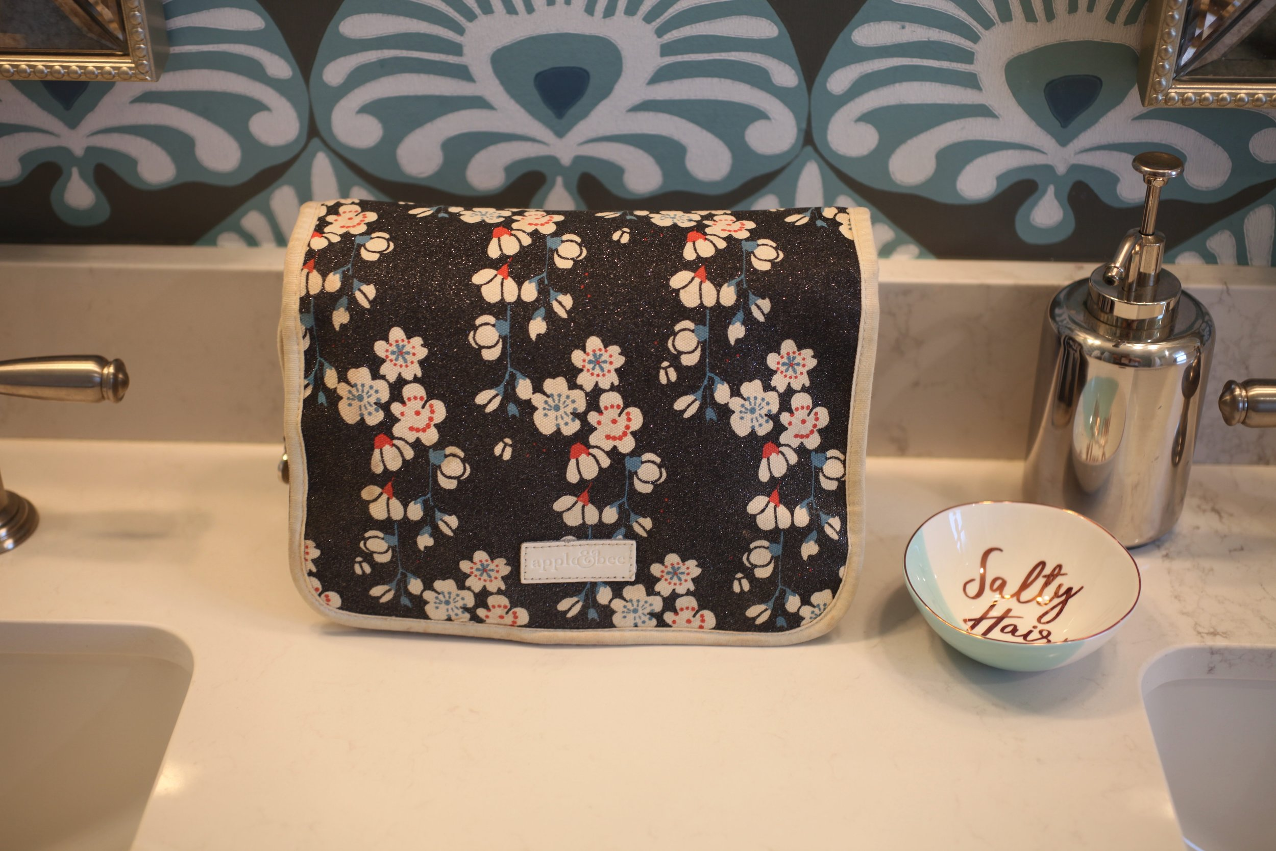 This gal is packed and ready to rock, always! I keep this hanging cosmetic bag stocked to make packing a breeze.
