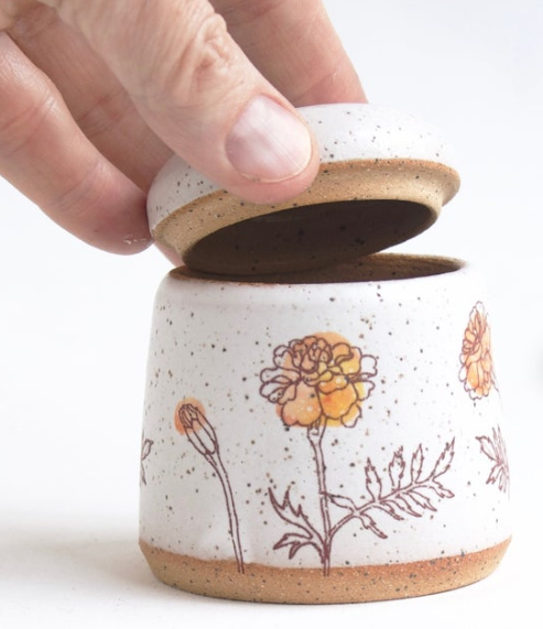 Personalized Urn:  This Shop  on Etsy has a beautiful collection, or you can use the search box on Etsy. It would be a good idea to check in with the parents prior to purchasing this gift.